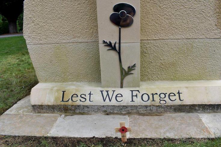 Close up of the steel poppy on Pelton War Memorial