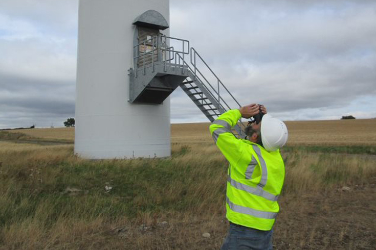 Pictured above: Tommi McElroy inspecting the blades at our Penny Hill Wind Farm, safely from the ground using binoculars